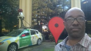 Coates with a Google Streetview car, which travels the world taking 360 degree photos of its surroundings for Google Maps