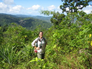 Cullman on her way to investigate the vegetation on a Malagasy farmer's land.