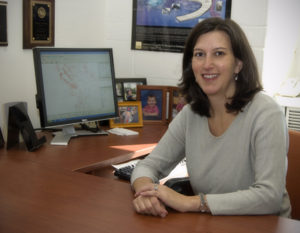 Rachel Davidson, Professor in the University of Delaware's Department of Civil and Environmental Engineering, in front of a computer model.