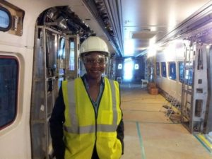 Civil Engineer Tysheina Robertson on a train, before seats have been added.