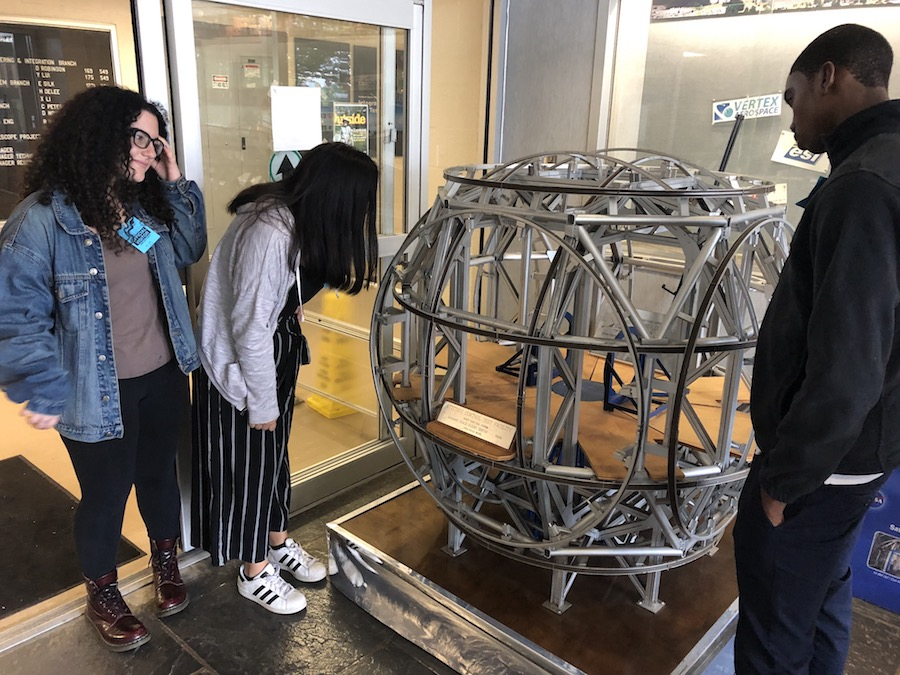 Students look at a coil system model